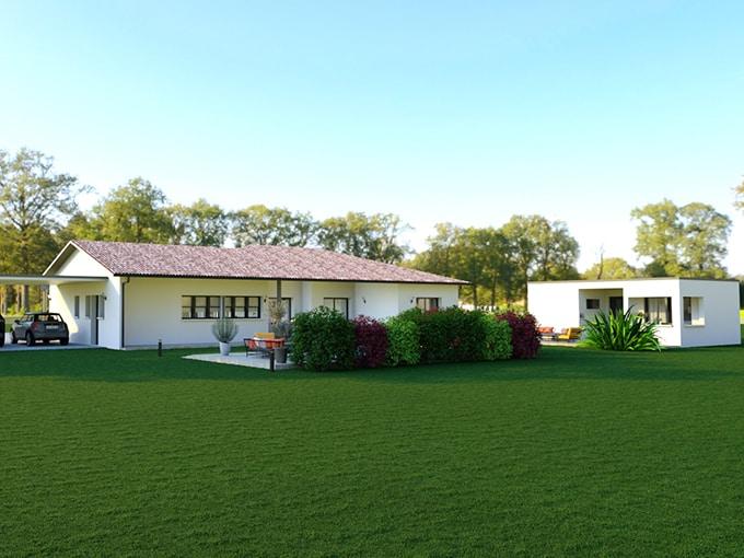 Maison en L avec dépendance et piscine dans un jardin