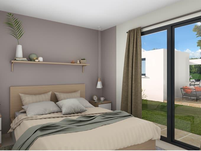 Chambre lumineuse avec baie-vitrée et vue sur le jardin