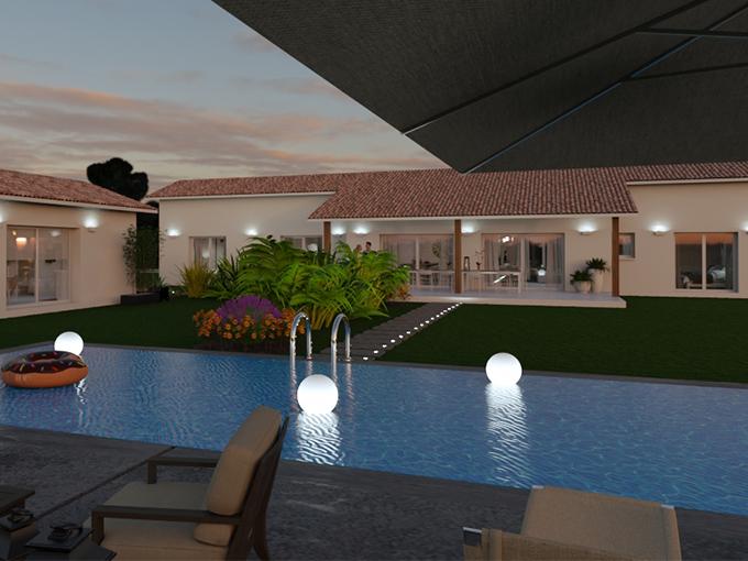 Vue de nuit d'une maison neuve avec sa piscine et la terrasse couverte