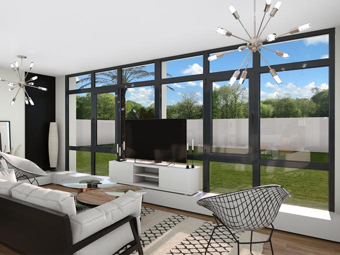 Grande verrière dans un salon avec canapé et espace TV