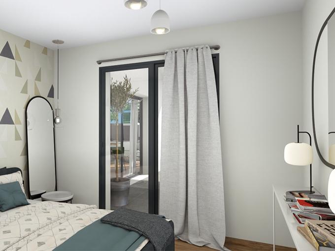 Chambre avec grand lit et porte fenêtre