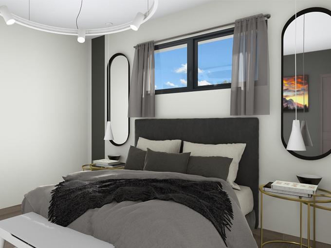 Grand lit d'une suite parentale avec fenêtres horizontales