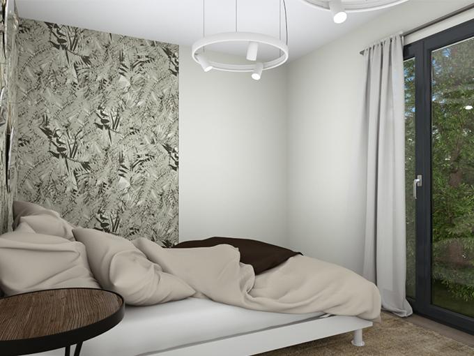 Chambre avec lit et porte fenêtre