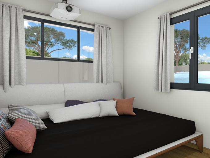Chambre avec lit banquette et fenêtres horizontales